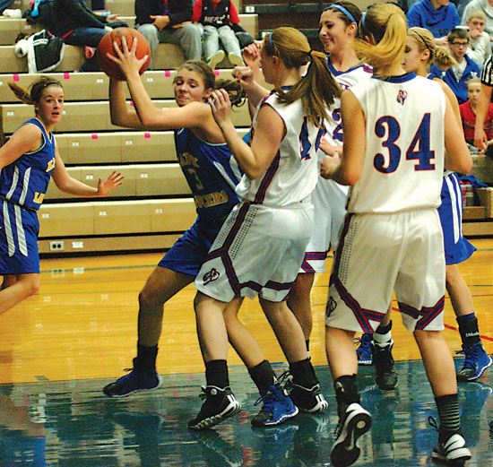 Lincolnview's Ashton Bowersock (3) comes away with a defensive rebounds amidst a hoard of Lady Knights during a NWC game at Crestview on Thursday evening. Bowersock was one of two Lady Lancers to score in double figures, but Crestview pulled away to a 44-34 victory. (Times Bulletin/Tina Eley)