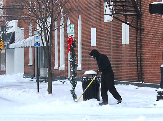 This person in the downtown area bundled up to shovel snow during the last storm on Jan. 6, including a full face mask. While the temperatures are not expected to dip quite as low this week more Arctic weather is on its way to Van Wert County. (TB file photo)