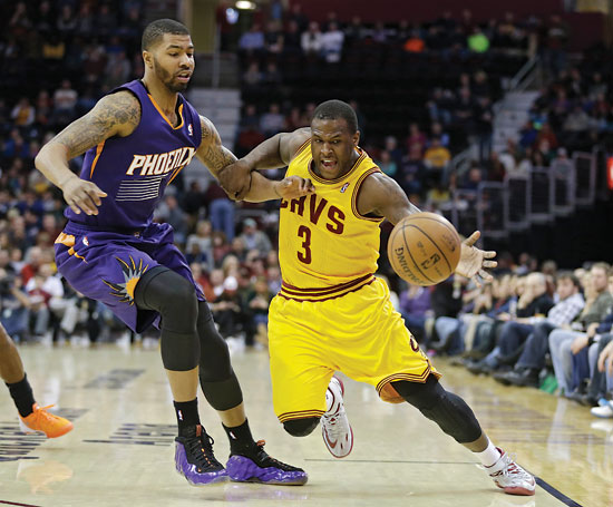 Cleveland Cavaliers' Dion Waiters (3) loses the ball under pressure from Phoenix Suns' Markieff Morris in the second quarter of an NBA basketball game, Sunday, Jan. 26, 2014, in Cleveland. (AP Photo/Mark Duncan)