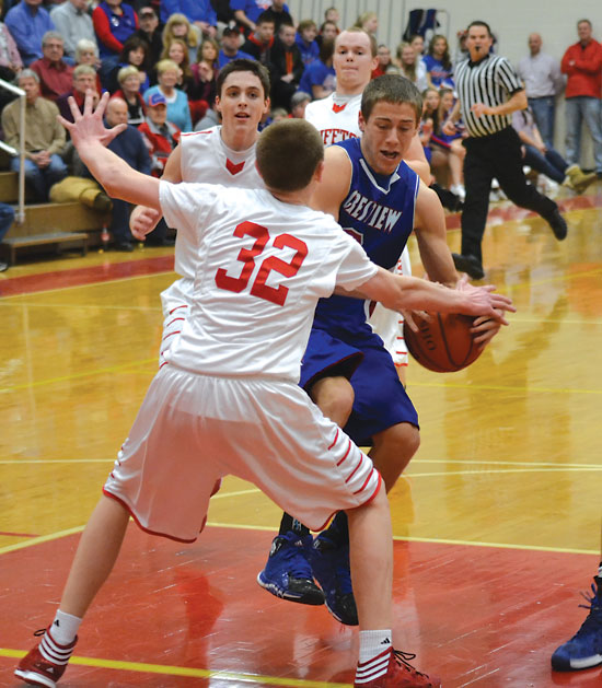 Crestview junior Preston Zaleski drives into the paint during the first half of the Knights' 53-40 win at Bluffton on Friday night. Crestview jumped out to a 14-0 in the game. Zaleski scored two points in the win. (Times Bulletin/John Parent)