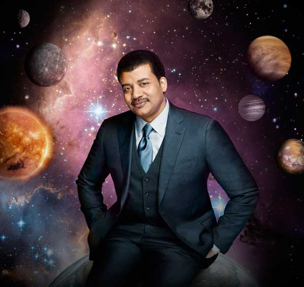 "This photo released by Fox shows Neil deGrasse Tyson, the astrophysicist who hosts the television show, ""Cosmos: A Spacetime Odyssey,"" premiering Sunday, March 9, 2014, 9:00-10:00 PM ET/PT on Fox and simultaneously across multiple U.S. Fox networks. The series will explore how we discovered the laws of nature and found our coordinates in space and time. (AP Photo/Fox, Patrick Eccelsine)"