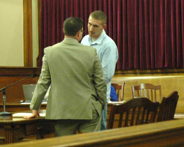 Shane Carroll confers with his attorney in court Wednesday after being sentenced on sex charges. Carroll was one of 17 persons to make appearances Wednesday in Van Wert County Court of Common Pleas. (Times Bulletin/Ed Gebert)