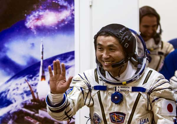 "FILE - This Nov. 7, 2013 file photo shows Japanese astronaut Koichi Wakata, a crew member of the International Space Station, waving prior to the launch of Soyuz-FG rocket at the Russian leased Baikonur cosmodrome, Kazakhstan. Wakata, along with U.S. astronaut Rick Mastracchio, will serve as on-board correspondents for a National Geographic special called ""Live From Space,"" airing Friday, March 14 at 8 p.m. EST on the National Geographic Channel. (AP Photo/Shamil Zhumatov, File)"