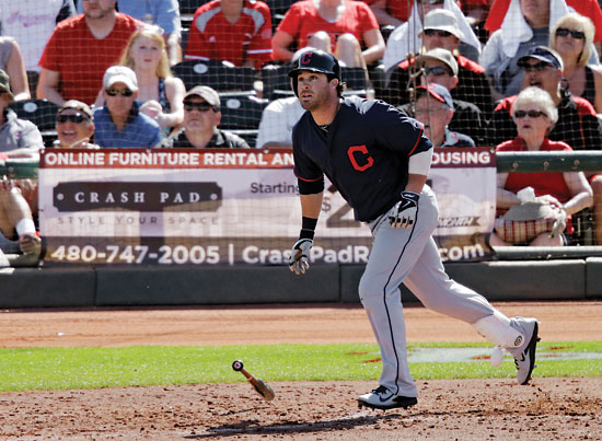 Cleveland Indians' Jason Kipnis watches his three-run home run off Cincinnati Reds relief pitcher J.J. Hoover in the sixth inning of a spring exhibition baseball game Monday, March 24, 2014, in Goodyear, Ariz. (AP Photo/Mark Duncan)
