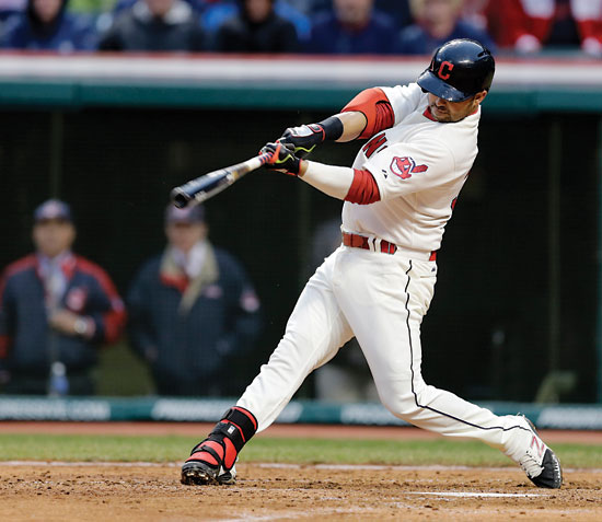 Cleveland Indians' Nick Swisher hits a two run home run off Minnesota Twins starting pitcher Mike Pelfrey in the sixth inning of a baseball game, Friday, April 4, 2014, in Cleveland. Lonnie Chisenhall scored. (AP Photo/Mark Duncan)