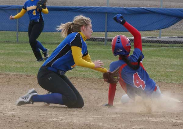 A Lincolnview infielder tags a sliding Crestview runner during Thursday's softball game. The Lady Knights were victorious, defeating the Lady Lancers 8-4. (Times Bulletin/Tina Eley)