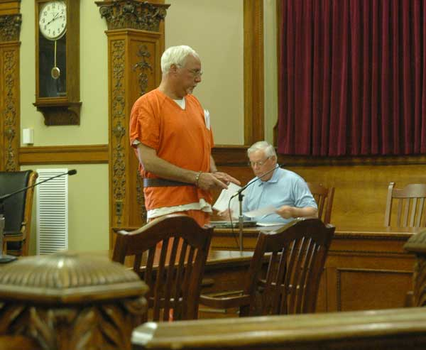 Robert Fishbein, former CEO of I & K Distributing in Delphos, enters the courtroom Thursday morning in Van Wert County Court of Common Pleas. Fishbein was arraigned on eight fifth-degree felony counts of violating a civil protective order, to which he pleaded not guilty. (Times Bulletin/Ed Gebert)