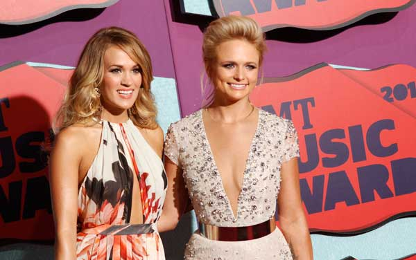 Carrie Underwood, left, and Miranda Lambert arrive at the CMT Music Awards at Bridgestone Arena on Wednesday, June 4, 2014, in Nashville, Tenn. (Photo by Wade Payne/Invision/AP)