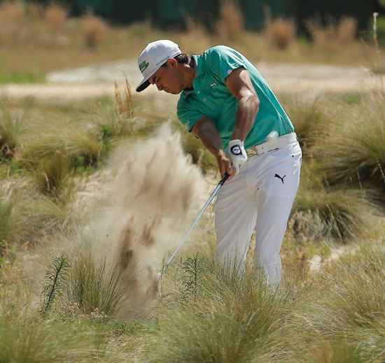 Rickie Fowler hits out of the long grass on the 18th hole during a practice round for the U.S. Open golf tournament in Pinehurst, N.C., Wednesday, June 11, 2014. The tournament starts Thursday. (AP Photo/Charlie Riedel)