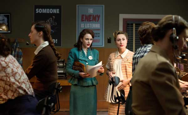 "This photo released by WGN America shows, Rachel Brosnahan, center, as Abby Isaacs, in a scene from the TV series, ""Manhattan."" The show debuts 9 p.m. ET/8 p.m. CT, Sunday, July 27, 2014, on cable channel WGN America. The drama is set in a makeshift, desolate New Mexico desert community, one of several that sprang up as part of the Manhattan Project aiming to beat Nazi Germany to the bomb. (AP Photo/WGN America, Greg Peters)"
