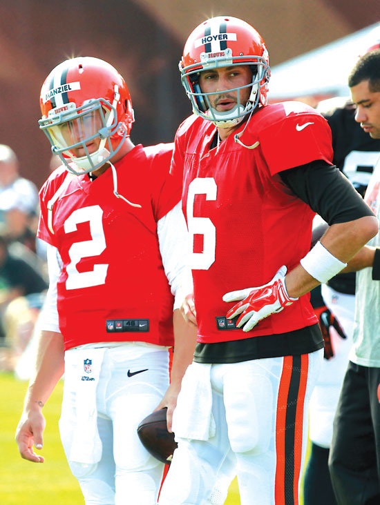 Cleveland Browns quarterbacks Johnny Manziel (2) and Brian Hoyer look on at the NFL football team's training camp in Berea, Ohio, Thursday, July 31, 2014. (AP Photo/Aaron Josefczyk)