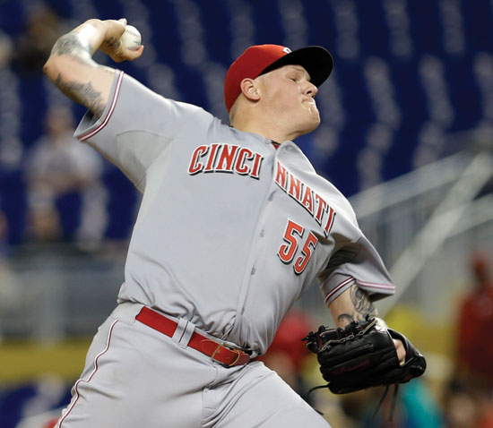 Cincinnati Reds' Mat Latos (55) pitches against the Miami Marlins in the first inning of a baseball game in Miami, Friday, Aug. 1, 2014. (AP Photo/Alan Diaz)