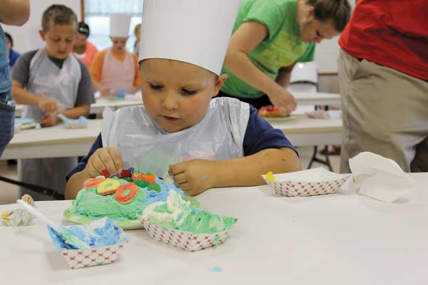 Marbletown Festival is right around the corner. One of the signature events is the Kids Cake Decorating Contest at 6:30 p.m. on Aug. 8 at Delphos Wesleyan Church. Little ones are each given a 4-inch round cake, icing and fun sugary candies to decorate with and earn a ribbon. (DHI Media file photo)