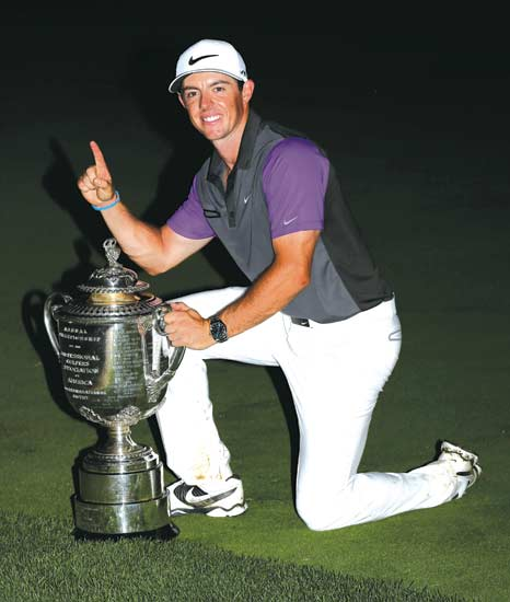Rory McIlroy, of Northern Ireland, holds up the Wanamaker Trophy after winning the PGA Championship golf tournament at Valhalla Golf Club on Sunday, Aug. 10, 2014, in Louisville, Ky. (AP Photo/David J. Phillip)