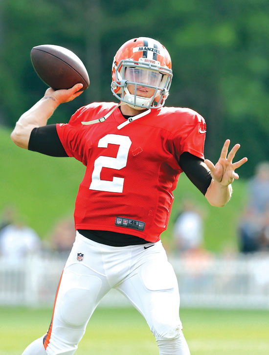 Cleveland Browns quarterback Johnny Manziel passes during practice at NFL football training camp in Berea, Ohio Wednesday, Aug. 6, 2014. Coach Mike Pettine said that Manziel and Brian Hoyer will get equal reps with the first team during the Browns' next exhibition game. (AP Photo/Mark Duncan)