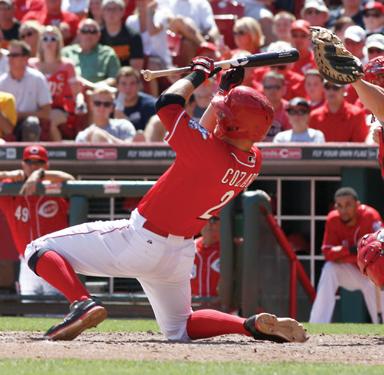 Cincinnati Reds' Zack Cozart goes down while trying to bunt in the ninth inning of a baseball game against the Boston Red Sox, Wednesday, Aug. 13, 2014, in Cincinnati. The Red Sox won 5-4. (AP Photo/David Kohl)