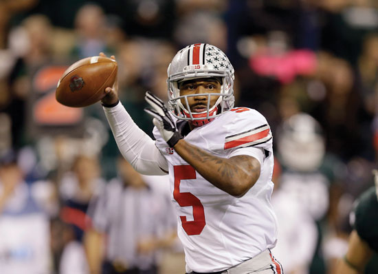 In this Dec. 7, 2013, file photo, Ohio State quarterback Braxton Miller throws a pass against Michigan State during the Big Ten Conference championship NCAA college football game in Indianapolis. Miller will miss the season due to injury. (AP Photo/Michael Conroy, File)