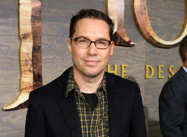 "FILE - This Dec. 2, 2013 file photo shows Bryan Singer at the Los Angeles premiere of ""The Hobbit: The Desolation of Smaug"" at the Dolby Theatre. A former child model accusing ""X-Men"" director Bryan Singer of sex abuse in Hawaii said he wants to dismiss the lawsuit _ not because it lacks merit but because he can't find a new attorney to represent him. Michael Egan III said in a court filing Wednesday that he previously sought the dismissal in sealed documents in federal court in Honolulu. He wants the case dismissed without prejudice, meaning he could file it again later. (Photo by Matt Sayles/Invision/AP, File)"
