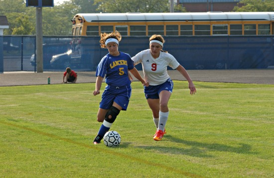 Lincolnview's Claire Clay battles against Deanna Wells of Crestview during NWC play on Monday in Convoy. The Lady Lancers scored a 9-0 win. (DHI Media/Tina Eley)