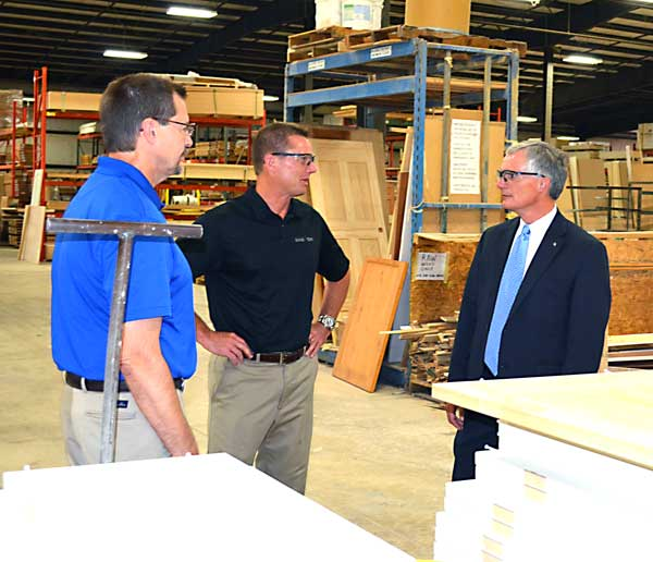 Rep. Bob Latta (R - Bowling Green) gets a look at the expanded facility at National Door and Trim on Grill Rd. in Van Wert Tuesday. He was shown around by President Tom Turnwald and Rick Anderson. Latta also stopped at the Times Bulletin for a chat about current governmental issues and milkshakes. (Photo submitted)