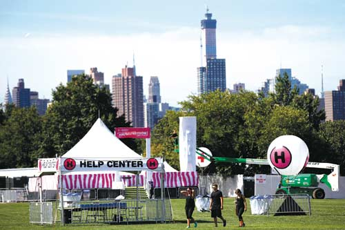 A help center, where attendees can get free water and electrolytes, and red cross balloon marking a medical tent can be seen at the Electric Zoo music festival venue on New York's Randall's Island, Friday, Aug. 29, 2014. The final day of last year's festival was called off after two people died from an overdose of MDMA combined with hyperthermia. (AP Photo/Jason DeCrow)