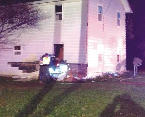 Car hits van on US 127, then runs into house