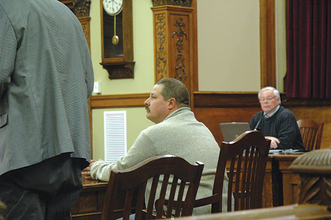 Richard Strunkenburg sits, watching his attorney speak at his sentencing hearing Tuesday morning in Van Wert County Court of Common Pleas. Strunkenburg pleaded guilty to felony charges stemming from mistreatment of animals at the county shelter while he was dog warden. (DHI Media/Ed Gebert)