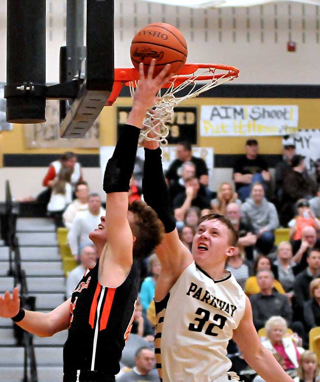 Parkway freshman Nick Hawk (32) skies to defend the rim against Versailles' Justin Ahrens on Friday night. Ahrens scored 29 points, and so did Parkway, in a 71-29 Tiger win. (DHI Media/Pat Agler)