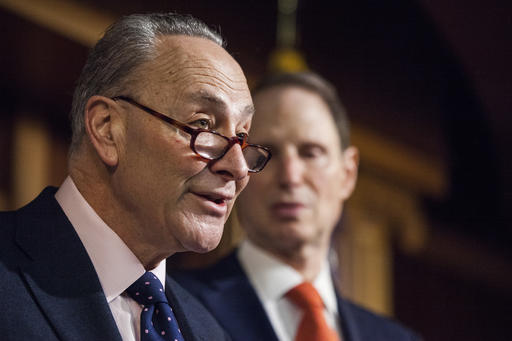 In this Jan. 5, 2017 file photo, Senate Minority Leader Charles Schumer of N.Y., left, accompanied by Sen. Ron Wyden, D-Ore., speaks during a news conference on Capitol Hill in Washington. Democrats planned hours of Senate speeches Monday to condemn the Republican push to obliterate President Barack Obama's health care overhaul, as the chamber's GOP leader stood by his party's plans to void the law and replace it later. (AP Photo/Zach Gibson, File)
