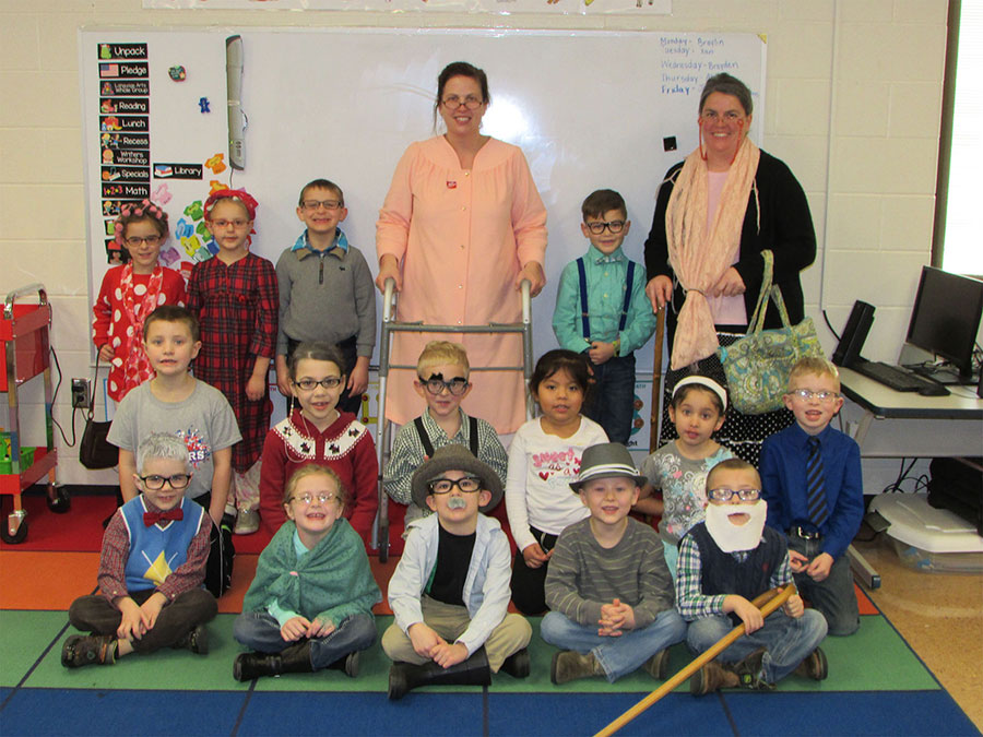 Kim Walls' Grover Hill Elementary Kindergarten class celebrated 100 days of learning on Tuesday. Students wore outfits that transformed them into 100-year-old men and women, some complete with wigs and canes. Pictured are (front row) Lincoln Crosser, Olivia Stoller, Jacob Wobler, Brandon Hire and Ian Scarberry (middle row) Braylin Sinn, Abbie Williams, Brayden Sinn, Ximena DeLeon, EhvaJean Esposito and Aden Burk (back row) Kinlee Miller, Phoebe Landwehr, Koner Feeney, Kim Walls, Easton Jay and Mandy Whitman.