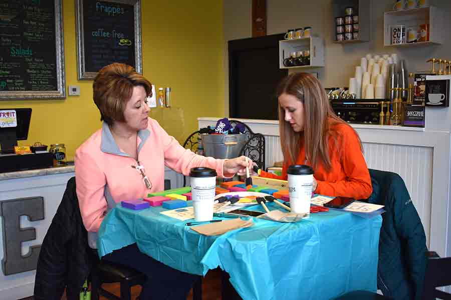 Becky Stepleton and Ashley Rose build a spring block sign at Brewed Expressions Sunday afternoon. A portion of the proceeds of the event benefited the Van Wert County Humane Society Shelter. (DHI Media/Kirsten Barnhart)