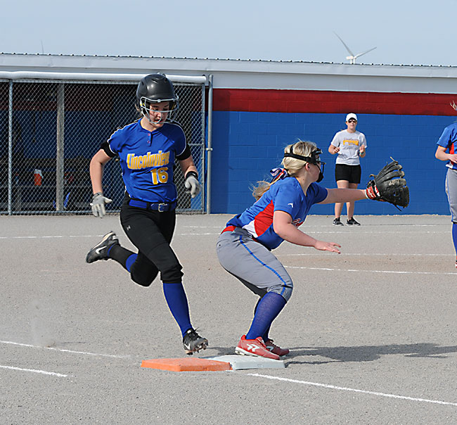 Lincolnview's Alena Looser (16) beats a throw to first as Crestview's Kristen Etzler stretches at the bag during a softball game in Convoy on Tuesday. The Lady Knights built a 5-0 lead and held on for a 5-3 win. (DHI Media/Tina Eley)