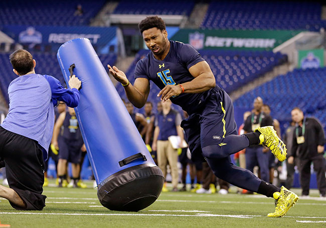 "In this March 5, 2017, file photo, Texas A&M defensive end Myles Garrett runs a drill at the NFL football scouting combine in Indianapolis. The Cleveland Browns are inclined to keep the No. 1 overall pick in next week's NFL draft despite getting offers for it. Sashi Brown, the team's vice president of football operations, said Wednesday, April 19, 2017, that the Browns ""feel really good about drafting No. 1.""(AP Photo/Michael Conroy)"