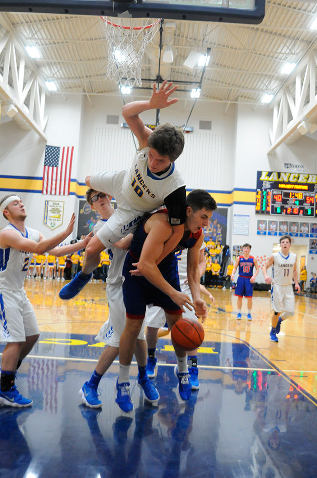 Crestview senior Derek Stout (11) is fouled by Lincolnview's Ethan Kemler (10) during a Northwest Conference game in Middle Point on Friday night. Stout scored 18 points in a 59-46 Crestview win. (DHI Media/Tina Eley)