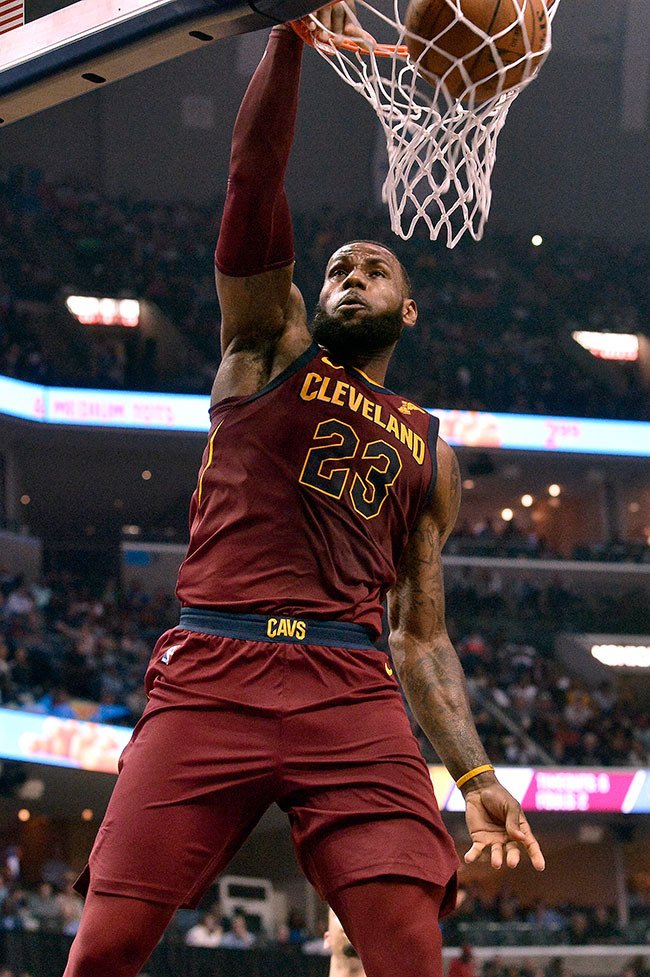 Cleveland Cavaliers forward LeBron James (23) dunks during the first half of the team's NBA basketball game against the Memphis Grizzlies on Friday, Feb. 23, 2018, in Memphis, Tenn. (AP Photo/Brandon Dill)