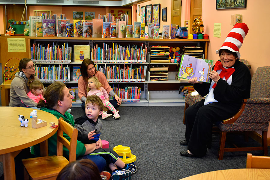 Children gathered at the Brumback Library Friday morning to hear Dr. Seuss Books read by the Cat in the Hat. (DHI Media/Kirsten Barnhart)