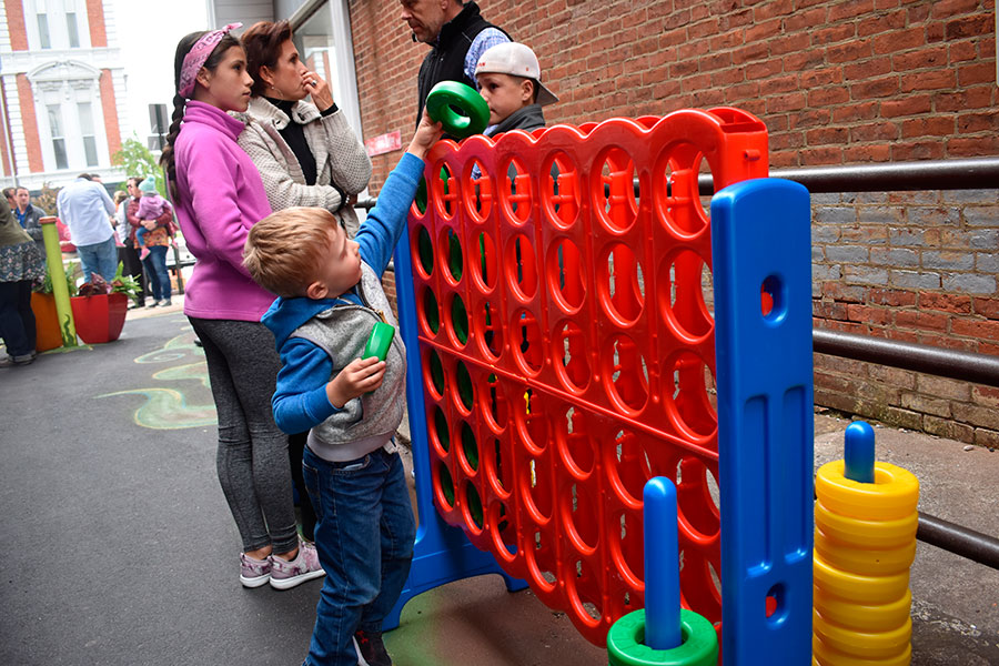 Grayson Baker enjoys the mega-connect four game in the recently opened Former Mayor Eugene Bagley Alley on Friday afternoon. (DHI Media/Kirsten Barnhart)