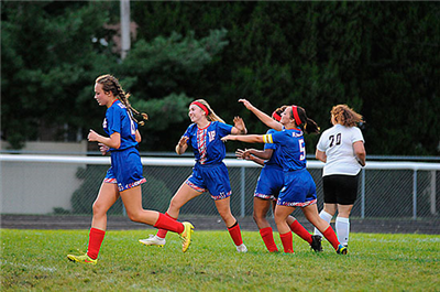A group of Lady Knights celebrating a goal during their win over the visiting Paulding Panthers Monday night. (DHI Media/ Tina Eley)