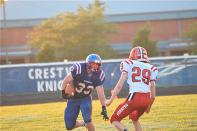 Crestview's running back Brody Brecht tries to shake a defender in the first quarter of their game against Bluffton. Brecht had two touchdowns and a 69 yard rush. (DHI Media/ Reid Maus)