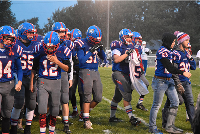 The Crestview football team carried Noah Riggenbach's jersey onto the field on Friday in support of the injured player. (DHI Media/Kirsten Barnhart)