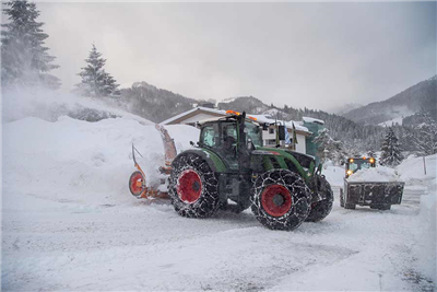 Snow is removed from a road in Spitzingsee, southern Germany, Tuesday, Jan.8, 2019. (Lino Mirgeler/dpa via AP