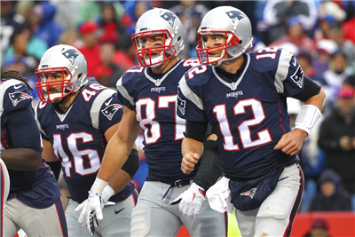 "n this Oct. 30, 2016, file photo, New England Patriots' Tom Brady (12), Rob Gronkowski (87) and James Develin (46) head back to the sideline after LeGarrette Blount scored a touchdown during the second half of the team's NFL football game against the Buffalo Bills in Orchard Park, N.Y. Gronkowski says he is retiring from the NFL after nine seasons. Gronkowski announced his decision via a post on Instagram Sunday, March 24, 2019, saying that a few months shy of this 30th birthday ""its time to move forward and move forward with a big smile."" (AP Photo/Bill Wippert, File)"