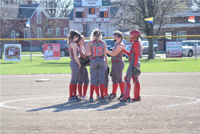 Van Wert meets at the mound during their WBL match up with Wapak, Tuesday night. Lauren Moore led the Lady Cougs as she had a two-run homerun and single during the loss. Van Wert's next league game is slated for Friday against St. Marys. (DHI Media/ Reid Maus)