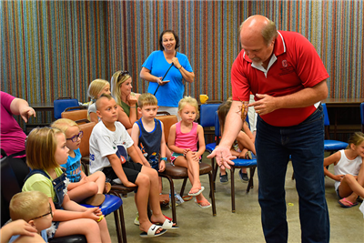 OSU Educator Curtis Young presents a walking stick during an insect program on Thursday. (DHI Media/Kirsten Barnhart)