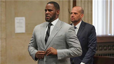 In this June 6, 2019, file photo, singer R. Kelly pleaded not guilty to 11 additional sex-related felonies during a court hearing before Judge Lawrence Flood at Leighton Criminal Court Building in Chicago. R. Kelly, already facing sexual abuse charges brought by Illinois prosecutors, was arrested in Chicago Thursday, July 11, 2019 on a federal grand jury indictment listing 13 counts including sex crimes and obstruction of justice. (E. Jason Wambsgans/Chicago Tribune via AP, Pool)