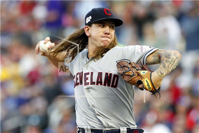 Cleveland Indians pitcher Mike Clevinger throws to a Minnesota Twins batter during the first inning of a baseball game Thursday, Aug. 8, 2019, in Minneapolis. (AP Photo/Jim Mone)