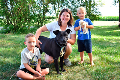Nadia had spent half of her life at the Van Wert County Humane Society Shelter before finding her forever home. Pictured are Kayla Mosure, who adopted Nadia, and her sons, Konner (left) and Caiden (right). (Photo courtesy of Jess Ritchey)