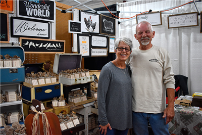 Leona and Jim Douglass, owners of Brown Bag Soap Co., pose in front of their creations at the Van Wert County Fair. (DHI Media/Kirsten Barnhart)