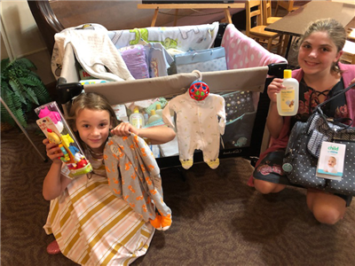 Sunday school children also helped in the ministry by donating small baby toys as one of their service projects. Elora and Ashlynn are shown with all of the donations. (Photo submitted)