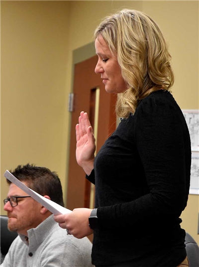 Vantage Career Center Board of Education's newest member, Kim Wannemacher from Ottoville, takes the oath of office. (DHI Media/Sherry Missler)